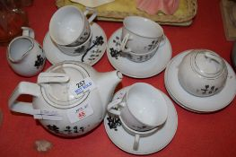 ORIENTAL TEA SET COMPRISING TEA POT, SUGAR BOWL, MILK JUG AND SIX CUPS AND SAUCERS