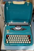 SMITH CORONA CALYPSO TYPEWRITER IN BLUE TRAVELLING CASE
