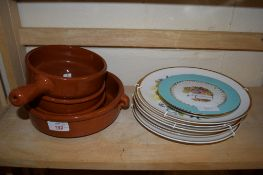 BROWN GLAZED POTTERY DISHES AND CHINA PLATES, MAINLY DECORATED WITH WILD FLOWERS, BY SPINK