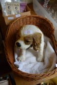 LARGE MODEL OF A KING CHARLES TYPE SPANIEL IN WICKER BASKET