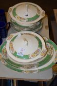 DINNER WARES INCLUDING TWO TUREENS AND COVERS, PLATES, SIDE PLATES, SERVING DISHES