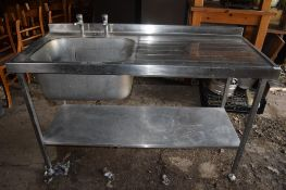 Single drainer large stainless steel Sink, on stand with shelf beneath.