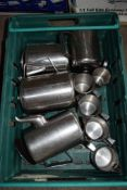 Crate: four large stainless steel Tea/Coffee Pots, t/w 5 various stainless steel Milk Jugs.