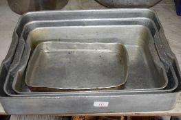 Four variously sized aluminium Baking Trays.