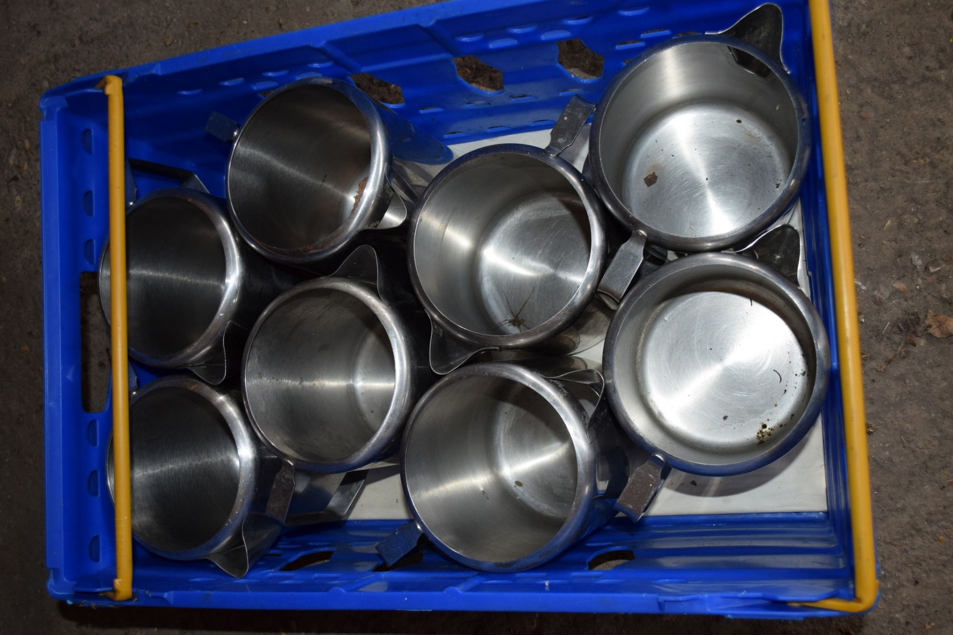 Crate: 8 large stainless steel Jugs.