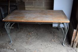 Large rectangular Dining Table, with ornate metal legs and moulding.