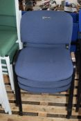 THREE METAL FRAMED STACKING UPHOLSTERED CHAIRS