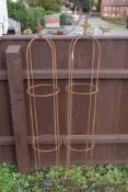 PAIR OF LARGE METAL GARDEN OBELISKS, EACH WITH A FLAME SHAPED FINIAL, HEIGHT APPROX 150CM