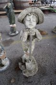 COMPOSITE MOULDED GARDEN FIGURE FORMED AS A BOY LEANING ON A SPADE, APPROX 63CM