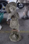 COMPOSITE GARDEN FIGURE DEPICTING A GIRL LEANING ON A RAKE, HEIGHT APPROX 63CM