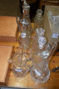 GROUP OF CUT GLASS WARES INCLUDING TWO PLATED CLARET JUGS, VARIOUS DECANTERS ETC