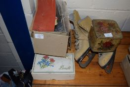 SMALL BOXED SEWING MACHINE WITH VARIOUS BOBBINS ETC AND A PAIR OF SKATING SHOES