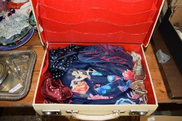 SMALL SUITCASE CONTAINING VARIOUS FABRICS