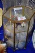 SMALL GLASS DISPLAY CABINET CONTAINING MINIATURE DISPLAYS OF FLOWERS