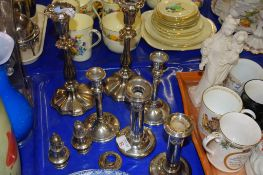 PAIR OF PLATED CANDELABRA AND OTHER SILVER PLATED CANDLESTICKS