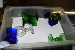 SMALL PLASTIC BOX CONTAINING GLASS EYE BATHS