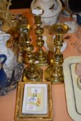 GROUP OF THREE PRINTS AND THREE BRASS CANDLESTICKS