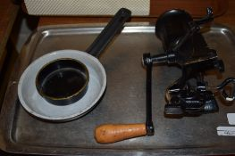 OLD MINCING MACHINE WITH WOODEN HANDLE AND WHITE METAL TRAY