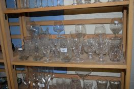 COLLECTION OF DRINKING GLASSES, WINE GLASSES AND BRANDY GLASSES ETC