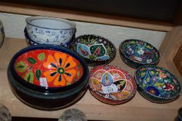 GROUP OF POTTERY DISHES
