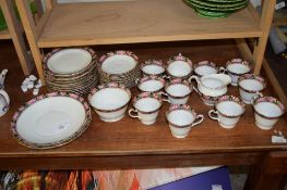 PART POTTERY TEA SERVICE WITH ROSE BORDER