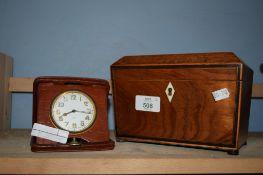 LIGHT WOOD CADDY WITH IVORY ESCUTCHEON AND A TRAVELLING ALARM CLOCK
