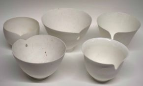Interesting group of studio pottery bowls modelled in white with a pierced design, the base