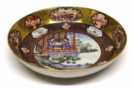 18th century Qianlong period saucer, decorated in polychrome with a Chinese family scene to the