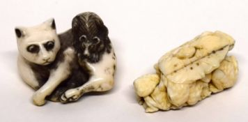 Two finely carved netsuke, one of a cat with a rat on its back