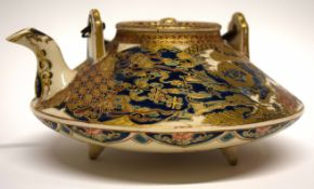 Satsuma ware teapot with wicker handle decorated in typical fashion with signature block in gold