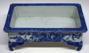 Japanese porcelain flower holder decorated with floral sprays, mounted on four feet, 37cm long x