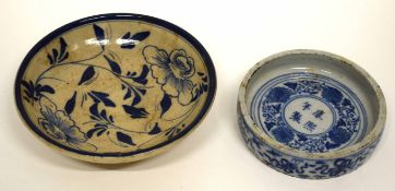 Small Chinese porcelain circular dish and further interesting Oriental pottery dish with a blue