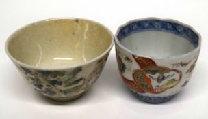 Two Chinese porcelain bowls one with polychrome decoration, one with calligraphy (2)