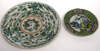 Japanese porcelain famille vert dish, the centre with a dragon decoration together with a small dish