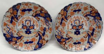 Two large Japanese porcelain chargers decorated in Imari style with shaped rims, 41cm diam (2)