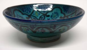 Persian style pottery bowl with geometric design on green ground