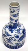 Chinese porcelain vase of mallet shape, decorated in underglaze blue with a dragon chasing the