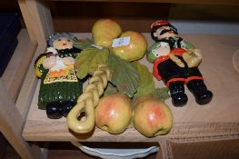 TWO DUTCH STYLE WOODEN DOLLS AND TWO PIECES OF WOODEN FRUIT