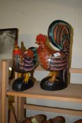 TWO WOODEN MODELS OF A COCKEREL AND A HEN