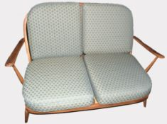 Mid century Ercol two seater sofa, upholstered with green diamond patterned cushions, 133cm wide
