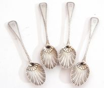 Set of four late Victorian tea spoons in bright cut Old English pattern with shell bowls,