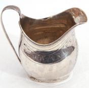 George III silver cream jug, the body with a vacant cartouche, an encircling band of foliate