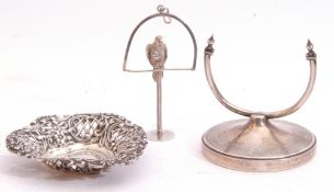 Mixed Lot: Unusual late 20th century pipe tamper in the form of a parrot on a hanging stand,