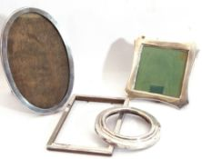 Mixed Lot: silver mounted photograph frames, a George V silver oval shaped example, wooden easel