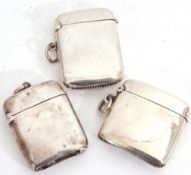 Mixed Lot: three hallmarked silver vesta cases of typical plain polished rectangular form, hinged
