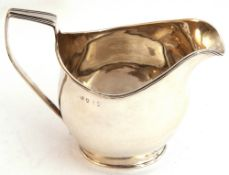 George III helmet shaped cream jug of bellied shape, with reeded square top handle and reeded rim,