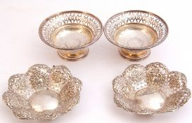 Mixed Lot: pair of Edward VII silver pierced bon-bon dishes, typically embossed with flowers,