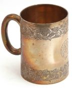 Victorian silver mug of tapering cylindrical form, engraved with a double frieze of leaves, the body