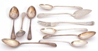 Mixed Lot: eight assorted George III bright cut tea spoons, various dates and makers, together