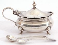 Hallmarked silver mustard of oval shape, the hinged lid with urn finial, blue glass liner,